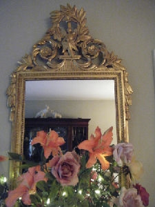 Flowers and a gold mirror