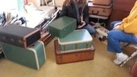 teal and brown vintage suitcases